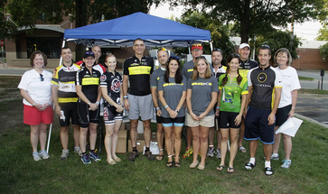 Club members pose for picture before the start of a charity ride